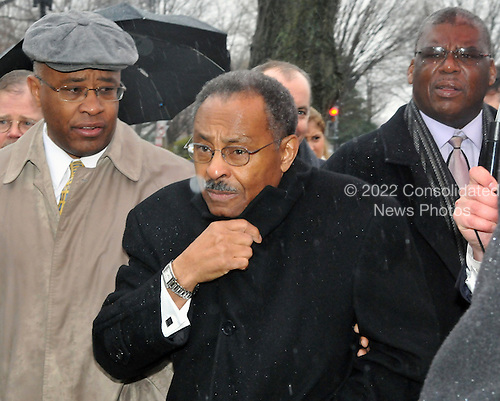 Washington, DC - January 6, 2009 -- United States Senator-designate Roland Burris (Democrat of Illinois) braves the cold rain as he departs the United States Capitol in Washington, DC on Tuesday, January 6, 2009 after the Secretary of the Senate turned him away from being seated..Credit: Ron Sachs / CNP.(RESTRICTION: NO New York or New Jersey Newspapers or newspapers within a 75 mile radius of New York City)