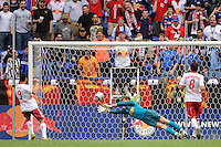 Juan Pablo Angel (9) of the New York Red Bulls beats Juventus F. C. goalkeeper Alex Manninger (13) to score in the 75th minute. The New York Red Bulls defeated Juventus F. C. 3-1 during a friendly at Red Bull Arena in Harrison, NJ, on May 23, 2010.