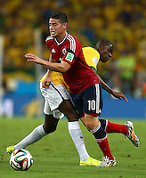 James Rodriguez of Colombia is fouled by Ramires of Brazil