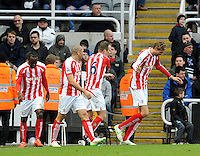 Peter Crouch (right) of Stoke City celebrates scoring their first goal with team mates