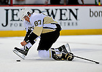 21 September 2009: Pittsburgh Penguins' center Sidney Crosby ties his skates prior to a pre-season game against the Montreal Canadiens at the Bell Centre in Montreal, Quebec, Canada. The Canadiens defeated the defending Stanley Cup Champion Penguins 4-3. Mandatory Credit: Ed Wolfstein Photo