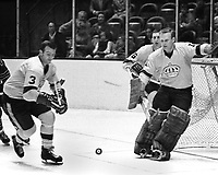 LA Kings action against the Seals 1968 photo. Dale Rolfe and goalie Wayne Rutledge. (Ron Riesterer/photo