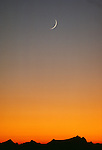 Crescent moon at sunset, North Cascades National Park, Washington