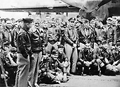 Orders in hand, Captain Marc A. Mitscher, United States Navy, skipper of the U.S.S. Hornet (CU-8) chats with Major General James Doolittle, United States Army.  Some of the 80 Army fliers who took part in the historic Japanese raid are pictured with the two fliers..Credit: U.S. Air Force via CNP