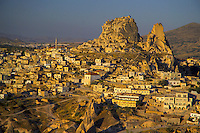 Goreme, Cappadocia, Nevsehir, Turkey. The village of Uchisar. A hot air balloon flight is one of the best ways to explore the fairy chimney landscape of Cappadocia and the Gorme National Park. Photo by Frits Meyst / MeystPhoto.com