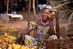 A woman sells mangoes in the market in Sonougouba, Mali, where the ACT Alliance has worked with local residents to encourage a sustainable economy, increase food security, and improve local governance.