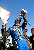 Jul. 26, 2009; Sonoma, CA, USA; NHRA top fuel dragster driver Antron Brown celebrates after winning the Fram Autolite Nationals at Infineon Raceway. The win was the third win in a row for Brown. Mandatory Credit: Mark J. Rebilas-