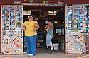 Paia General Store: clerk Kawewehi and a customer giving the Shaka sign; Paia, Maui, Hawaii.