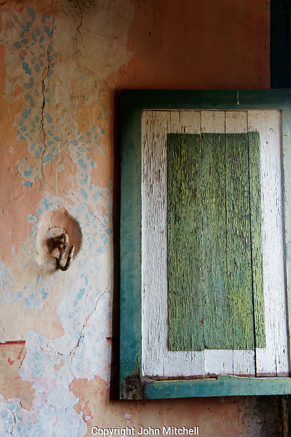 Wooden shutter and wall hook in main building at Hacienda Yaxcopoil, Yucatan, Mexico.