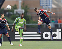 New England Revolution defender Chris Tierney (8) heads the ball. In a Major League Soccer (MLS) match, the New England Revolution tied the Seattle Sounders FC, 2-2, at Gillette Stadium on June 30, 2012.