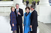 Washington, DC- January 20, 2001-- United States President Bill Clinton and first lady Senator Hillary Rodham Clinton (Democrat of New York) welcome President-elect George W. Bush and his wife Laura at the White House for a reception ceremony, before the swearing-in ceremony at the United States Capitol..Credit: Ron Sachs / CNP