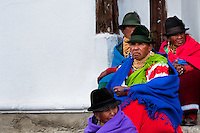 "Old women, wearing colorful clothes, watch a procession during the Inti Raymi festival in Pichincha province, Ecuador, 26 June 2010. Inti Raymi, ""Festival of the Sun"" in Quechua language, is an ancient spiritual ceremony held in the Indian regions of the Andes, mainly in Ecuador and Peru. The lively celebration, set by the winter solstice, goes on for various days. The highland Indians, wearing beautiful costumes, dance, drink and sing with no rest. Colorful processions in honor of the God Inti (Sun) pass through the mountain villages giving thanks for the harvest and expressing their deep relation to the Mother Earth (Pachamama)."