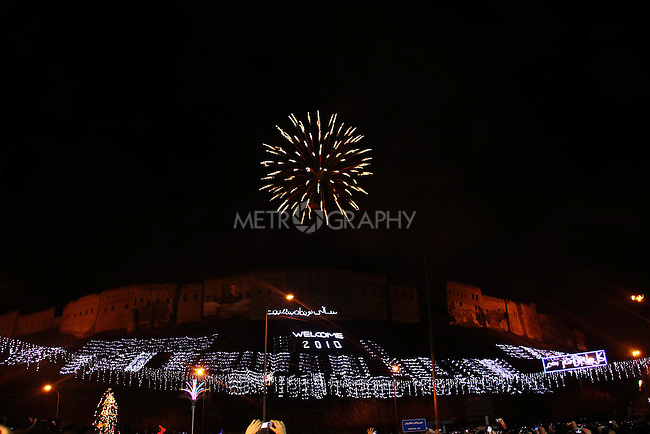IRAQ, ERBIL:  A firework explodes over the citadel in Erbil...Revelers brought in the new year all across Kurdistan with shows of fireworks and enormous street parties...Photo by Safeq Shukre/Metrography