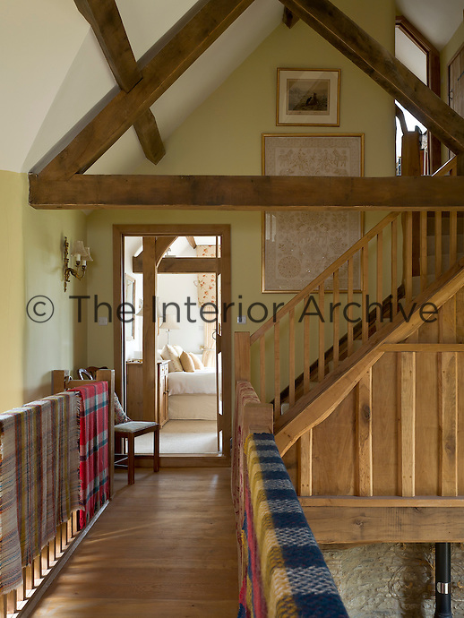 The original beams of the barn are constructed in the traditional A-frame