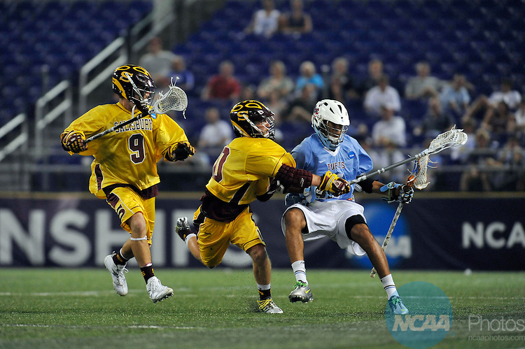 29 MAY 2011:  Kyle Gallagher (10) and Perry Craz (9) of Salisbury University defend Tom Bragg (4) of Tufts University during the Division III Men's Lacrosse Championship held at M+T Bank Stadium in Baltimore, MD.  Salisbury defeated Tufts 19-7 for the national title. Larry French/NCAA Photos