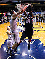 INDIANAPOLIS, IN - FEBRUARY 19: Mamadou Datt #34 of the Duquesne Dukes dunks the ball against Andrew Smith #44 of the Butler Bulldogs at Hinkle Fieldhouse on February 19, 2013 in Indianapolis, Indiana. Butler defeated Duquesne 68-49. (Photo by Michael Hickey/Getty Images) *** Local Caption *** Mamadou Datt; Andrew Smith