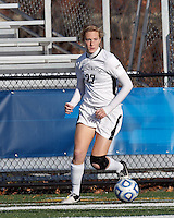College of St Rose forward Jennifer Busk (27) looks to pass.. In 2012 NCAA Division II Women's Soccer Championship Tournament First Round, College of St Rose (white) defeated Wilmington University (black), 3-0, on Ronald J. Abdow Field at American International College on November 9, 2012.