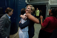NORFOLK, VA--Assistant Coach Kate Paye congratulates Amber Orrange after defeating West Virginia University at the Ted Constant Convocation Center at Old Dominion University for the second round of the 2012 NCAA Championships. The Cardinal advanced to the West Regionals in Fresno with a score of 72-55.