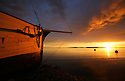 Wooden boat with storm clouds