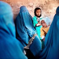 Women and children waiting outside the Italian hospital in Herat.