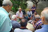 Palermo, Sicily, Italy, May 2007. Old men play cards in the park. The streets of Palermo are lined with historical buildings.  The rugged nature of sicily harbours beautiful villages and ruins of ancient civilizations. Photo by Frits Meyst/Adventure4ever.com