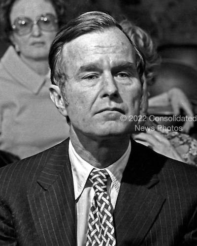 """United States Ambassador to China George H.W. Bush listens to a U.S. Senator's questions during his confirmation hearing to be Director of the U.S. Central Intelligence Agency (CIA) in Washington, D.C. on December 16, 1975..Credit: Benjamin E. """"Gene"""" Forte / CNP"""