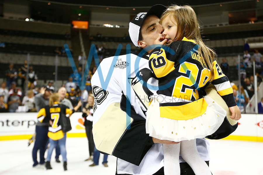 Marc-Andre Fleury #29 of the Pittsburgh Penguins kisses his daughter following their 3-1 win against the San Jose Sharks during game six of the Stanley Cup Final at SAP Center in San Jose, California on June 12, 2016. (Photo by Jared Wickerham / DKPS)