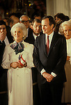 Vice President George H.W. Bush and wife Barbara (holding U.S. and Austrian flags) at a White House ceremony welcoming Austrian President Rudolf Kirchsläger in February 1984.