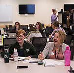 Elana Harnish, left, and Brianne Dowler, right, participate in the Discovering Common Ground icebreaker near the beginning of the Marketing Symposium on November 4, 2015 in Schoonover Center. Photo by Emily Matthews