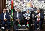 """Palestinian ministers of unity government in Gaza Strip meet with the aid convoy of """"Miles of Smiles""""  in Gaza city June 30, 2014. Photo by Mohammed Asad"""