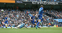 Leicester City's Shinji Okazaki shoots past Manchester City's Nicolas Otamendi (grounded) to score his sides first goal<br /> <br /> Photographer Stephen White/CameraSport<br /> <br /> The Premier League - Manchester City v Leicester City - Saturday 13th May 2017 - Etihad Stadium - Manchester<br /> <br /> World Copyright &copy; 2017 CameraSport. All rights reserved. 43 Linden Ave. Countesthorpe. Leicester. England. LE8 5PG - Tel: +44 (0) 116 277 4147 - admin@camerasport.com - www.camerasport.com