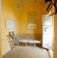 In the entrance hall the yellow ochre distemper on the walls glows against the faded terracotta of the floor tiles