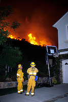 870000320 la county firemen work to protect private homes in agoura as the topanga wildfire flares up on a nearby ridge in los angeles county california