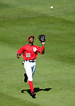 15 June 2006: Alfonso Soriano, outfielder for the Washington Nationals, pulls in a fly ball against the Colorado Rockies at RFK Stadium, in Washington, DC. The Rockies defeated the Nationals, 8-1 to sweep the four-game series...Mandatory Photo Credit: Ed Wolfstein Photo...