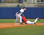 Former Rebel Justin Henry tags out Ole Miss' Alex Yarbrough (2) at Ole Miss baseball alumni game at Oxford-University Stadium in Oxford, Miss. on Saturday, February 5, 2011.