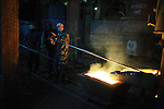 NDOLA, ZAMBIA MARCH 24: Pan-De, age 23, a Chinese supervisor, stands with unidentified Zambian workers as they toil in a copper smelter on March 24, 2007 in Ndola, Zambia. Eastern Union Limited is a China based company who buys Copper from Congo DRC, and brings it to Ndola to their Copper smelter. The smelter was shipped from China and operates 24 hours a day in an Industrial area in Ndola. The copper is eventually trucked to Dar es Salaam in Tanzania and on ships to China. The Chinese industry's thirst for raw materials has seen metals prices increase a lot the last years. Tens of thousands of Chinese has come to Africa the last years to work in infrastructure projects and businesses. Chinese companies are often the lowest bidders for contracts, pricing out the more expensive European companies. The Chinese people often live where they work and rarely interact with the local population. Most Chinese don't speak English and they are mostly staying in the compounds cooking their Chinese food, and watching Chinese Television and DVDs. .(Photo by Per-Anders Pettersson)...