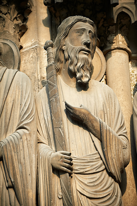 South Porch left jam. Gothic statue of Philip with sword. Cathedral of Chartres, France.  A UNESCO World Heritage Site. .