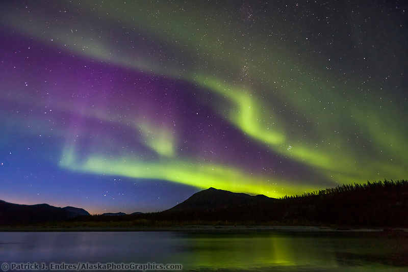 Aurora borealis reflecting in the Koyukuk River, Brooks Range, Arctic, Alaska.