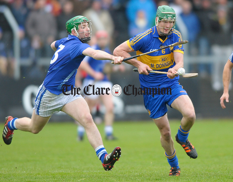 Cathal Mc Inerney of Cratloe in action against Enda Barrett of Newmarket On Fergus during the senior county hurling final at Cusack Park. Photograph by John Kelly.