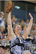 A fan cheers on the Durham Bulls on Saturday, July 2, 2011. The Durham Bulls face the Gwinnett Braves in a four-game, two-city series during Independence Weekend. Photo by Al Drago. .