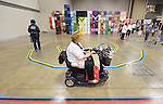 Women, including one in a motorized cart, navigate a prayer labyrinth during at the United Methodist Women Assembly in the Kentucky International Convention Center in Louisville, Kentucky, on April 25, 2014.