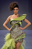Model walks runway in an outfit by Amal Sarieddine fashion; during Couture Fashion Week, September 16, 2011.