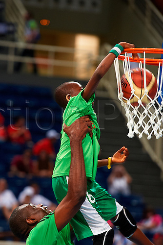 03.07.2011. Athens, Greece.  Special Olympics World Summer Games from Athens. Mutombo Jr dunks the basket with the help of his father, Dikembe Mutombo