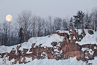 The full moon over snow covered cliffs in Michigan's Upper Peninsula.