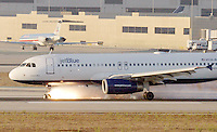 Sep 21, 2005; Los Angeles, CA, USA; A JetBlue airliner with its front landing gear stuck sideways safely landed Wednesday, balancing on its back wheels as it slowed on the runway at Los Angeles International Airport. Flames shot off the front landing gear as the plane ground to a halt with firefighters at the ready. The aircraft with landing gear problems had circled the Los Angeles area for more than two hours as the pilots dumped fuel over the ocean and officials tried to determine how to make an emergency landing. The pilots discovered the plane's front wheels were turned sideways and stuck as they tried to retract the gear shortly after takeoff.The back landing gear was also down as the plane circled, but it appeared to be in the correct position. Officials planned to try to land the aircraft, relying on the back wheels, at Los Angeles International Airport, which has longer runways than surrounding airports and more emergency equipment.The plane first circled the Long Beach Airport, about 30 miles south of Burbank, then was cleared to land at Los Angeles.  Mandatory Credit: Photo by Marianna Day Massey/ZUMA Press. (©) Copyright 2005 by Marianna Day Massey