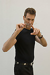Uri Geller at home Berkshire England 2008. Bending spoon 4th image taken at 16. 36. 32 pm.