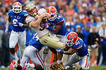Three Gator defenders struggle to bring down FSU tight end Nick O'Leary after a reception in the first half of the #2 ranked Florida State Seminoles 37-7 victory over the Florida Gators at Ben Hill Griffin Stadium in Gainesville, Florida November 30, 2013.