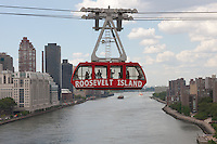 The newly renovated Roosevelt Island Tram crosses over the East River headed for Manhattan.