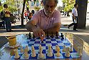 A man plays chess on the public square in Santiago, Chile