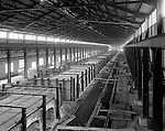 Pittsburgh PA:  View of Swindell Dressler manufacturing plant - furnace aisle 1932.  Swindell Dressler International Company was based in Pittsburgh, Pennsylvania. The company was founded by Phillip Dressler in 1915 as American Dressler Tunnel Kilns, Inc.  In 1930, American Dressler Tunnel Kilns, Inc. merged with William Swindell and Brothers to form Swindell-Dressler Corporation. The Swindell brothers designed, built, and repaired metallurgical furnaces for the steel and aluminum industries. The new company offered extensive heat-treating capabilities to heavy industry worldwide.